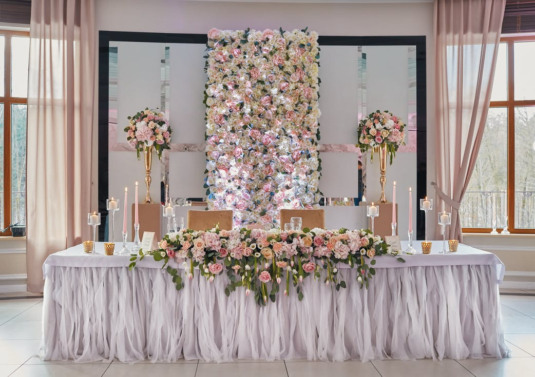 Unique decoration with flowers of the bride and groom's table