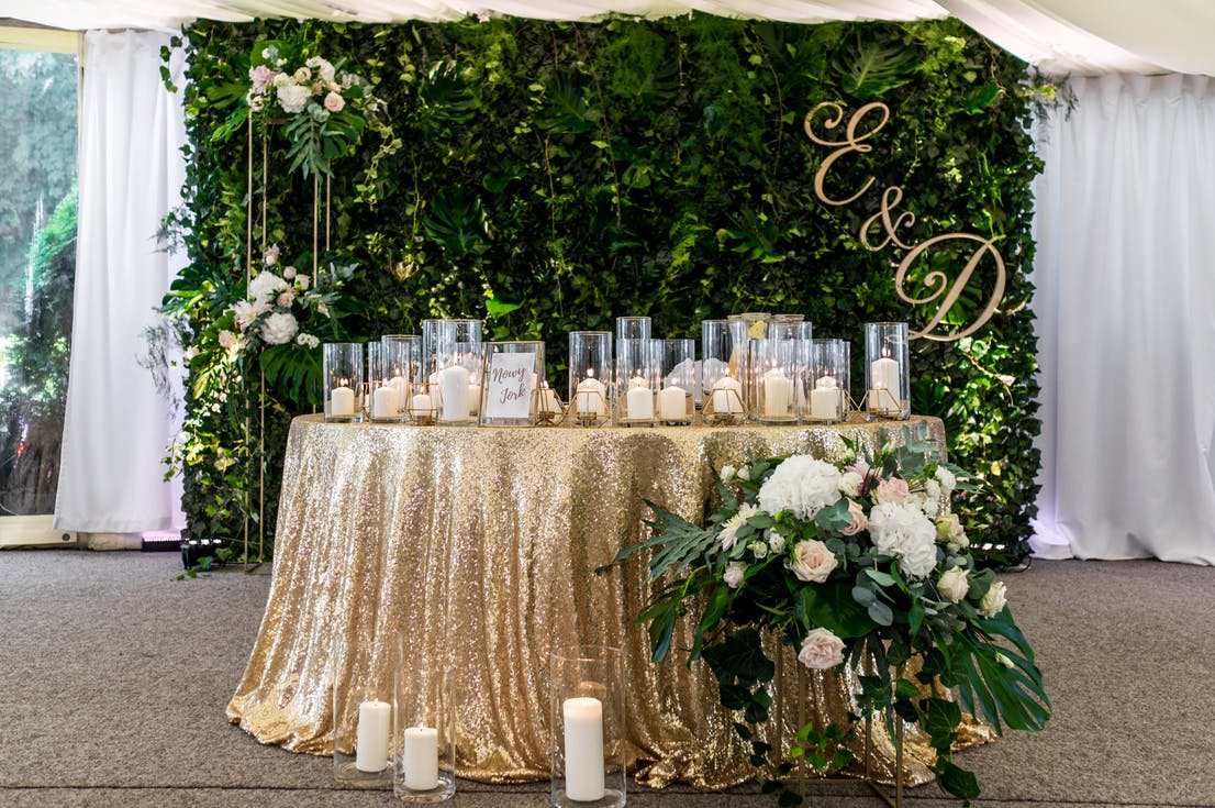 Beautiful decoration of the wedding hall - the table of the newlyweds