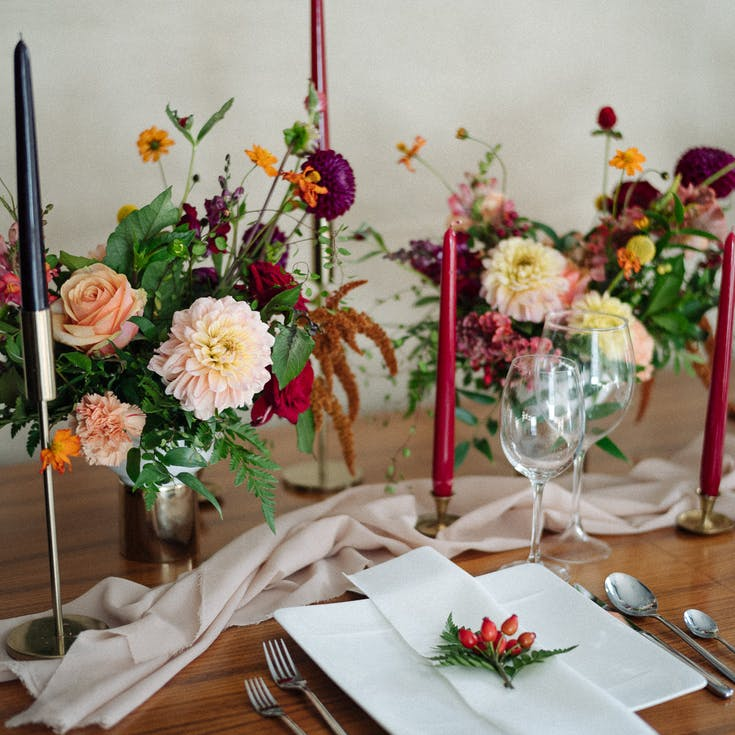 Vases of flowers and candles on the wedding table