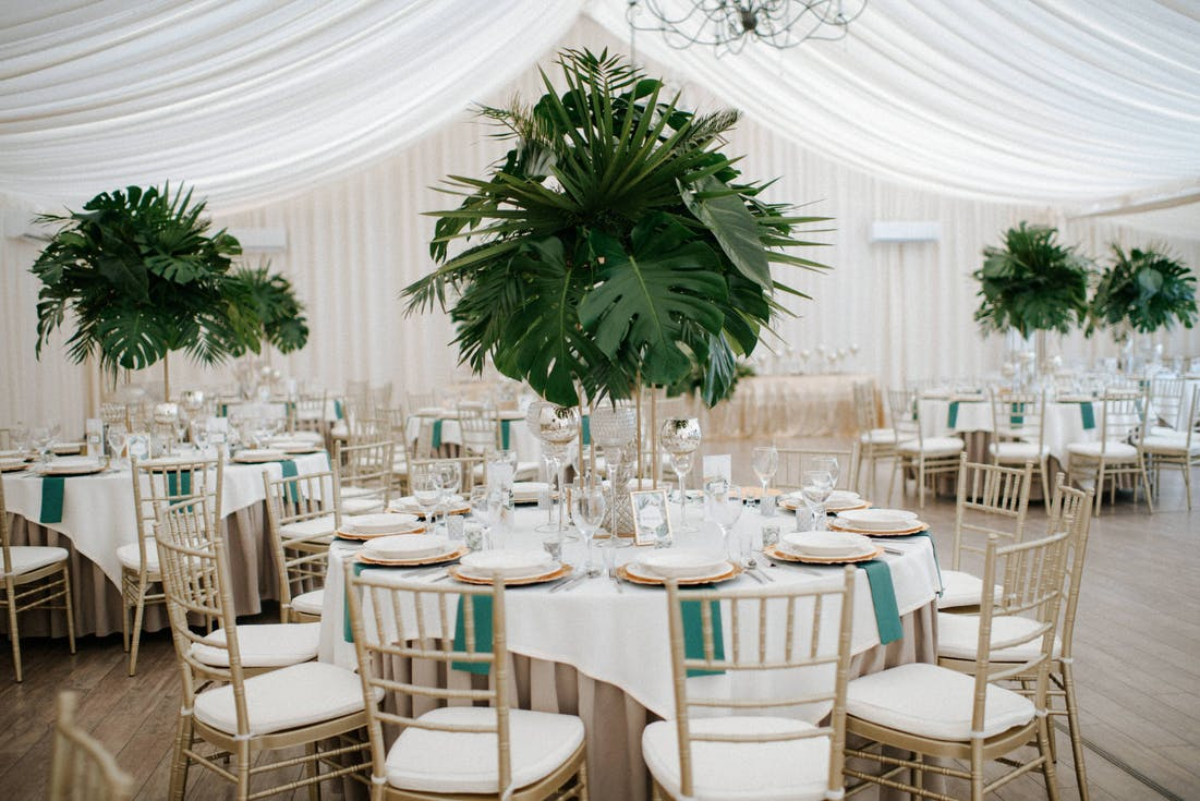 Tall floral arrangements in the wedding hall