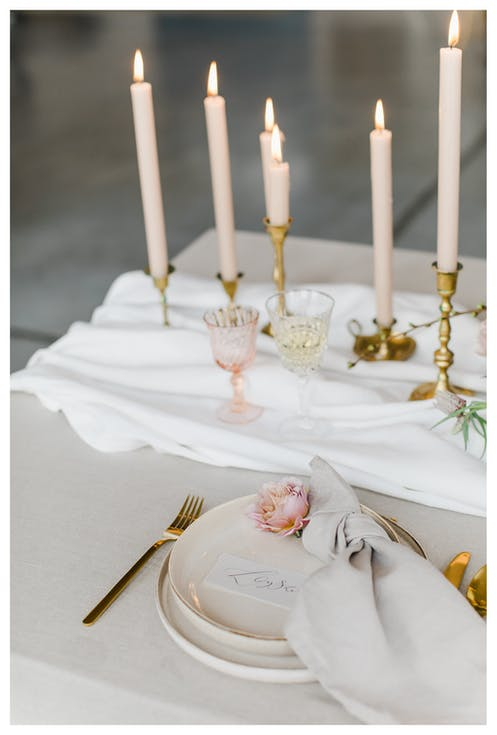 Conical candles in wedding hall decorations