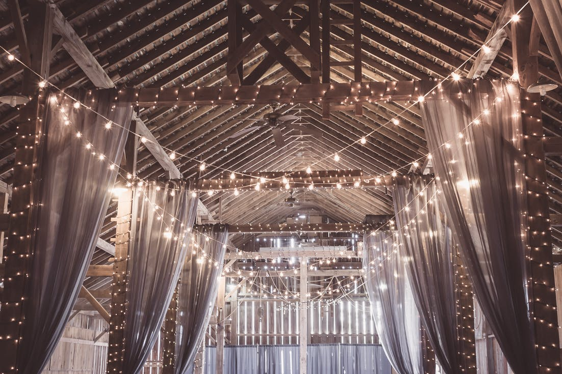 Decoration of the wedding hall with light - lights in the barn